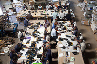 Workers at Colourprint in Nairobi assemble brochures for Barclays Bank.