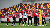 Brentford players get ready to form a huddle ahead of kick-off during Brentford vs Coventry City, Sky Bet EFL Championship Football at the Brentford Community Stadium on 17th October 2020