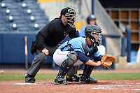 Home plate umpire Blake Carnahan and Charlotte Stone Crabs catcher Maxx Tissenbaum (19) during a game against the Fort Myers Miracle on April 16, 2014 at Charlotte Sports Park in Port Charlotte, Florida.  Fort Myers defeated Charlotte 6-5.  (Mike Janes/Four Seam Images)