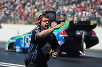 Aug. 7, 2011; Kent, WA, USA; NHRA funny car crew member for driver Tim Wilkerson during the Northwest Nationals at Pacific Raceways. Mandatory Credit: Mark J. Rebilas-