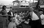Works office factory party outing annual coach trip to the seaside Southend on Sea Essex England 1974. 1970s Uk  A man playing a Penny Whistle.