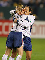 Julie Foudy is hugged by Kristine Lilly as she leaves the field after her last soccer match, at the Home Depot Center in Carson, Calif., Tuesday, Dec., 7, 2004.