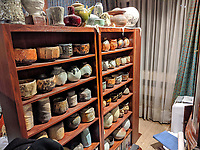 BNPS.co.uk (01202 558833)<br /> Pic: AdamPartridgeAuctioneers/BNPS<br /> <br /> Pictured: Shelves full of pots in the living room<br /> <br /> A huge collection of pottery and ceramics found stacked inside the suburban home of an elderly couple has sold for almost £200,000.<br /> <br /> Leonard and Alison Shurz filled every room of their three bed house with ceramic pieces they had gathered from all over the world.<br /> <br /> The Aladdin's Cave of pots, bowls, plates, vases and jugs was found by a stunned auctioneer who had the daunting task of cataloguing it all.