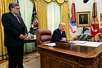 United States President Donald J. Trump accompanied by US Attorney General William P. Barr, left, makes remarks before signing an executive order in the Oval Office of the White House in Washington, DC that will punish Facebook, Google and Twitter for the way they police content online, Thursday, May 28, 2020. <br /> Credit: Doug Mills / Pool via CNP/AdMedia