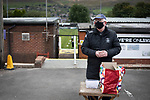 Mossley 4 Pickering Town 1, 26/09/2020. Seel Park, Northern Premier League Division One North West. A programme seller waiting for spectators before Mossley take on Pickering Town. Formed in 1903, Mossley moved into their current ground in 1912 and have played there ever since. The home team won the match 4-1, watched by a crowd of 400, the maximum number permitted in the ground under COVID-19 social distancing regulations. Photo by Colin McPherson.