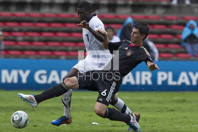 .Action photo of Robin Yalcin (R) of Germany and Alfred Koroma (L) of USA, during game of the FIFA Under 17 World Cup game, held at Queretaro.