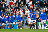 Samoa replacement Anthony Perenise walks out past The Webb Ellis Cup - Mandatory byline: Rogan Thomson - 03/10/2015 - RUGBY UNION - Stadium:mk - Milton Keynes, England - Samoa v Japan - Rugby World Cup 2015 Pool B.