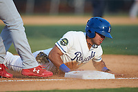 Jose Marquez (4) of the Burlington Royals slides head-first into third base against the Johnson City Cardinals at Burlington Athletic Stadium on July 15, 2018 in Burlington, North Carolina. The Cardinals defeated the Royals 7-6.  (Brian Westerholt/Four Seam Images)