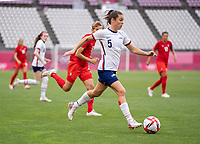 KASHIMA, JAPAN - AUGUST 2: Kelley O'Hara #5 of the USWNT dribbles during a game between Canada and USWNT at Kashima Soccer Stadium on August 2, 2021 in Kashima, Japan.