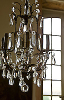 An 18th century Italian crystal chandelier hangs above the table in the dining room