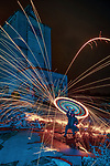 """Pictured:  Stambridge Mill, Rochford, Essex<br /> <br /> Amazing photos show sparks illuminating British landmarks as they fly from what appears to be a disc of colourful light.  This unique effect is the result of long-exposure night-time shots of a whisk stuffed with steel wool, which is set alight and spun at the end of a metal chain.<br /> <br /> Amateur photographer Dmitrij Dimek is passionate about what he calls 'light paintings', and took these photos at castles, beaches and other settings around Essex and London.  The 38 year old, who grew up in Poland but now lives in Southend-on-Sea, Essex, said: """"When I first found out about light painting with steel wool, I thought it was an outstanding way to connect with photography.  SEE OUR COPY FOR DETAILS.<br /> <br /> Please byline: Dmitrij Dimek/Solent News<br /> <br /> © Dmitrij Dimek/Solent News & Photo Agency<br /> UK +44 (0) 2380 458800"""