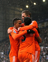 Pictured: Gylfi Sigurdsson of Swansea (TOP) celebrating his equaliser with team mates L-R Scott Sinclair and Neil Taylor. Saturday, 04 February 2012<br /> Re: Premier League football, West Bromwich Albion v Swansea City FC v at the Hawthorns Stadium, Birmingham, West Midlands.
