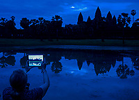Tourist with Mobile devices photographing Angkor Wat at Sunrise, Cambodia