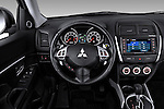 Steering wheel view of a 2012 Mitsubishi Outlander Sport.