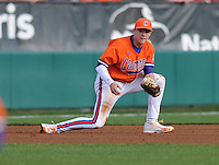 Third baseman Richie Shaffer (8) of the Clemson Tigers struggles to gram a grounder in the webbing of his glove a game against the University of Alabama-Birmingham on Feb. 17, 2012, at Doug Kingsmore Stadium in Clemson, South Carolina. UAB won 2-1. (Tom Priddy/Four Seam Images)