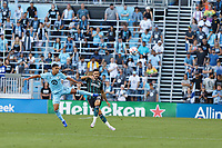 ST PAUL, MN - AUGUST 14: Emanuel Reynoso #10 of Minnesota United FC and Derrick Williams #3 of the Los Angeles Galaxy during a game between Los Angeles Galaxy and Minnesota United FC at Allianz Field on August 14, 2021 in St Paul, Minnesota.