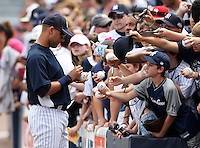 April 3, 2010:  Shortstop Derek Jeter (2) of the New York Yankees signs autographs before the annual Futures Game during Spring Training at Legends Field in Tampa, Florida.  Photo By Mike Janes/Four Seam Images