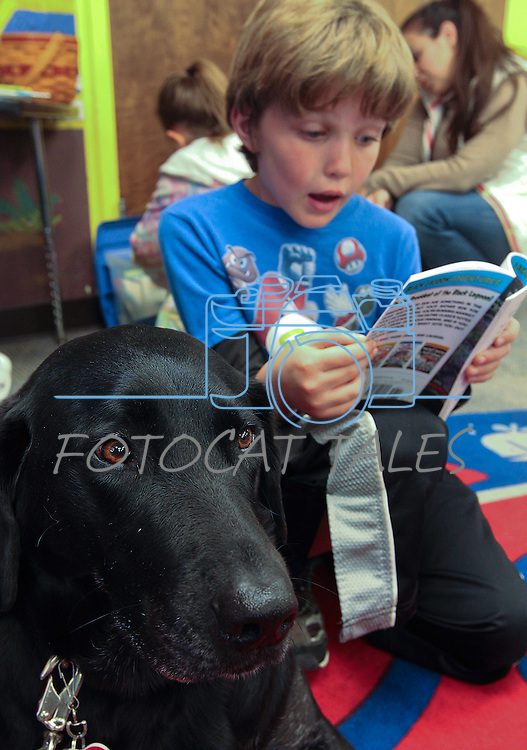 Derrick Johnson, 8, reads to Kalli during a Love on A Leash event at the Carson City Library, in Carson City, Nev., on Saturday, Dec. 17, 2011. .Photo by Cathleen Allison