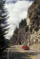 AJ3699, Mount Rainier, scenic road, Mount Rainier National Park, Cascades, Cascade Range, Washington, Red car approaches a tunnel on the Stevens Canyon Road at Mount Rainier National Park in the state of Washington.