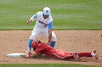 Tyler McDonough (13) of the North Carolina State Wolfpack is tagged out by Mikey Madej (2) of the North Carolina Tar Heels as he attempts to steal second base at Boshamer Stadium on March 27, 2021 in Chapel Hill, North Carolina. (Brian Westerholt/Four Seam Images)