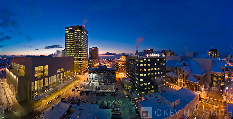 Rooftop view of the Anchorage skyline, with the Dena'Ina Civic and Convention Center in the foreground, twilight, winter, Southcentral Alaska, USA.