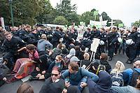 """Ca. 2.000 Menschen beteiligten sich am Samstag den 20. September 2014 in Berlin am sog. """"Marsch fuer das Leben"""" des konservativ-christlichen Bundesverband Lebensrecht e.V. Die Teilnehmer das Marsches waren zum Teil aus Holland, Gross Britannien, den USA und Polen angereist. Martin Lohmann, Vorsitzender des Vereins, begruesste unter den Anwesenden ausdruecklich die rechte AfD-Politikerin Beatrice von Storck.<br /> Der Marsch wurde lautstark von Frauenorganisationen und linken Gruppen begleitet. Mehrfach kam es zu kurzen Sitzblockaden, so dass die Marschroute geaendert werden musste. Die Polizei raeumte die Sitzblockaden mit Schlaegen, Tritten und eigens fuer diesen Zweck erprobten Schmerzgriffen.<br /> 20.9.2014, Berlin<br /> Copyright: Christian-Ditsch.de<br /> [Inhaltsveraendernde Manipulation des Fotos nur nach ausdruecklicher Genehmigung des Fotografen. Vereinbarungen ueber Abtretung von Persoenlichkeitsrechten/Model Release der abgebildeten Person/Personen liegen nicht vor. NO MODEL RELEASE! Don't publish without copyright Christian-Ditsch.de, Veroeffentlichung nur mit Fotografennennung, sowie gegen Honorar, MwSt. und Beleg. Konto: I N G - D i B a, IBAN DE58500105175400192269, BIC INGDDEFFXXX, Kontakt: post@christian-ditsch.de<br /> Urhebervermerk wird gemaess Paragraph 13 UHG verlangt.]"""