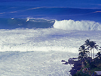 Surfer riding a huge wave at Waimea Bay, North Shore of Oahu, during the Quiksilver Eddie Aikau Competition