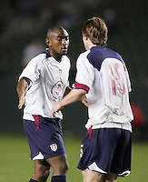 Marvell Wynne, left, Eddie Gaven, right, USA over Trinidad, 6-1, Wednesday, Jan. 12, 2005, in Carson, California.