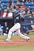 Asheville Tourists center fielder Terry McClure (5) swings at a pitch during a game against the Kannapolis Intimidators at McCormick Field on May 19, 2016 in Asheville, North Carolina. The Intimidators defeated the Tourists 10-7. (Tony Farlow/Four Seam Images)