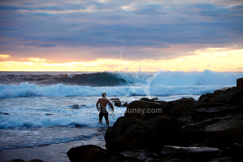 Surf at the Fairy Bower Point during a Sunrise at Manly Beach.