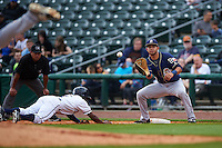 San Antonio Missions first baseman Luis Domoromo (7) waits for a pickoff attempt as Terrance Gore  dives back to first with umpire Nestor Ceja looks on during a game against the NW Arkansas Naturals on May 31, 2015 at Arvest Ballpark in Springdale, Arkansas.  NW Arkansas defeated San Antonio 3-1.  (Mike Janes/Four Seam Images)
