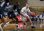 SIOUX FALLS, SD - MARCH 8: Baylor Scheierman #3 of the South Dakota State Jackrabbits drives to the basket against DeShang Weaver #14 of the Oral Roberts Golden Eagles during the Summit League Basketball Tournament at the Sanford Pentagon in Sioux Falls, SD. (Photo by Dave Eggen/Inertia)