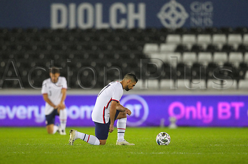 12th November 2020; Liberty Stadium, Swansea, Glamorgan, Wales; International Football Friendly; Wales versus United States of America; Sebastian Lletget of USA takes a knee against racism efore kick off