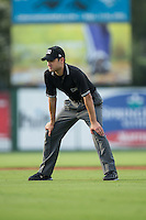 Umpire Reid Joyner handles the calls on the bases during the South Atlantic League game between the Hagerstown Suns and the Kannapolis Intimidators at CMC-Northeast Stadium on August 16, 2015 in Kannapolis, North Carolina.  The Suns defeated the Intimidators 4-3 in game two of a double-header.  (Brian Westerholt/Four Seam Images)