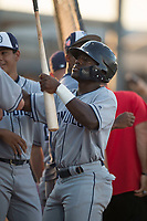 AZL Padres 1 second baseman Lee Solomon (28) is congratulated by teammates after hitting a home run during an Arizona League game against the AZL Padres 2 at Peoria Sports Complex on July 25, 2018 in Peoria, Arizona. The AZL Padres 1 defeated the AZL Padres 2 10-1. (Zachary Lucy/Four Seam Images)