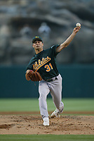Ted Lilly of the Oakland Athletics during a 2003 season MLB game at Angel Stadium in Anaheim, California. (Larry Goren/Four Seam Images)
