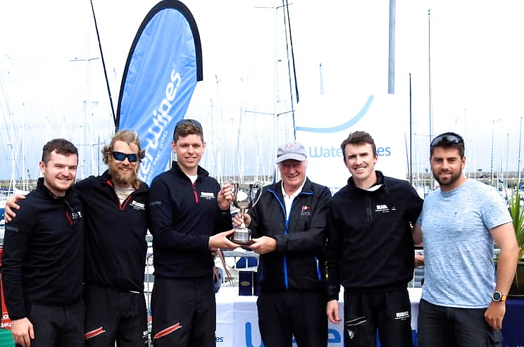 Line up the usual suspects….HYC Commodore Paddy Judge (centre) with the victorious Headcases