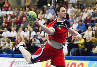 08 JAN 2012 - LONDON, GBR - Great Britain line player Chris Mcdermott shoots during the men's 2013 World Handball Championships qualification match against Austria at the National Sports Centre in Crystal Palace, Great Britain .(PHOTO (C) 2012 NIGEL FARROW)