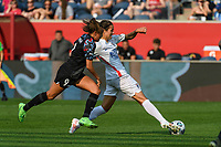 BRIDGEVIEW, IL - JULY 18: Dzsenifer Marozsan #8 of the OL Reign plays the ball as Mallory Pugh #9 of the Chicago Red Stars defends during a game between OL Reign and Chicago Red Stars at SeatGeek Stadium on July 18, 2021 in Bridgeview, Illinois.