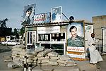 Saddam Hussein bullet holes posters Basra Iraq  1984. 1980s