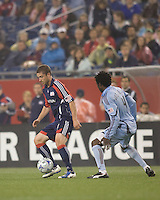 New England Revolution midfielder Chris Tierney (8) controls ball as Colorado Rapids defender Ugo Ihemelu (4) defends. The New England Revolution tied the Colorado Rapids, 1-1, at Gillette Stadium on May 16, 2009.