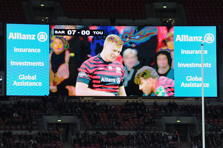 20131018 Copyright onEdition 2013©<br /> Free for editorial use image, please credit: onEdition<br /> <br /> Chris Ashton of Saracens is seen on the large screen during the Heineken Cup match between Saracens and Stade Toulousain at Wembley Stadium on Friday 18th October 2013 (Photo by Rob Munro)<br /> <br /> For press contacts contact: Sam Feasey at brandRapport on M: +44 (0)7717 757114 E: SFeasey@brand-rapport.com<br /> <br /> If you require a higher resolution image or you have any other onEdition photographic enquiries, please contact onEdition on 0845 900 2 900 or email info@onEdition.com<br /> This image is copyright onEdition 2013©.<br /> This image has been supplied by onEdition and must be credited onEdition. The author is asserting his full Moral rights in relation to the publication of this image. Rights for onward transmission of any image or file is not granted or implied. Changing or deleting Copyright information is illegal as specified in the Copyright, Design and Patents Act 1988. If you are in any way unsure of your right to publish this image please contact onEdition on 0845 900 2 900 or email info@onEdition.com