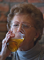 Peggy Moyer, 79, drinks one of the first beers sold at Old Bag of Nails restaurant and bar in downtown Westerville, Ohio, Thursday, February 23, 2006. The business occupies a building at the main crossroads in the city that was home to the Anti-Saloon League.<br />