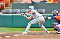 North Carolina Tar Heels left fielder Dylan Enwiller (6) squares to bunt during a game against the Clemson Tigers at Doug Kingsmore Stadium on March 9, 2019 in Clemson, South Carolina. The Tigers defeated the Tar Heels 3-2 in game one of a double header. (Tony Farlow/Four Seam Images)