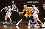 SIOUX FALLS, SD - MARCH 8: Sam Griesel #5 of the North Dakota State Bison tries to hold off defenders Xavier Fuller #3 and Kruz Perrott-Hunt #5 of the South Dakota Coyotes during the Summit League Basketball Tournament at the Sanford Pentagon in Sioux Falls, SD. (Photo by Richard Carlson/Inertia)