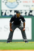 International League umpire Doug Vines handles the calls at second base during the game between the Durham Bulls and the Charlotte Knights at Knights Stadium on August 18, 2013 in Fort Mill, South Carolina.  The Bulls defeated the Knights 8-5 in Game One of a double-header.  (Brian Westerholt/Four Seam Images)