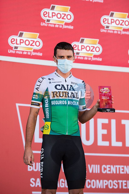Álvaro Cuadros (ESP) Caja Rural-Seguros RGA most aggressive rider from yesterday's stage at sign on before the start of Stage 14 of La Vuelta d'Espana 2021, running 165.7km from Don Benito to Pico Villuercas, Spain. 28th August 2021.     <br /> Picture: Cxcling | Cyclefile<br /> <br /> All photos usage must carry mandatory copyright credit (© Cyclefile | Cxcling)