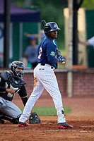 Elizabethton Twins shortstop Yeltsin Encarnacion (17) at bat in front of catcher Gabriel Brito (52) during a game against the Bristol Pirates on July 28, 2018 at Joe O'Brien Field in Elizabethton, Tennessee.  Elizabethton defeated Bristol 5-0.  (Mike Janes/Four Seam Images)