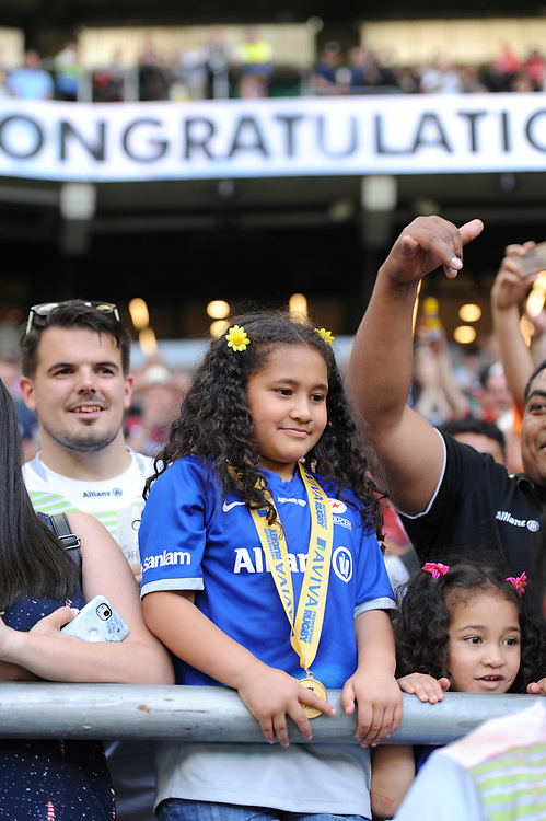 Mako Vunipola of Saracens gives his winners medal to a young fan during the Aviva Premiership Rugby Final between Exeter Chiefs and Saracens at Twickenham Stadium on Saturday 26th May 2018 (Photo by Rob Munro/Stewart Communications)