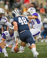 8 October 2016: Amherst College Purple & White Defensive Back John Rak, a Sophomore from Los Altos, CA, kicks with Craig Carmilani, a Junior from Washington Township, NJ, holding during a game against the Middlebury College Panthers at Alumni Stadium in Middlebury, Vermont. The Panthers edged out the Purple & While 27-26. Mandatory Credit: Ed Wolfstein Photo *** RAW (NEF) Image File Available ***